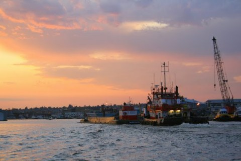 Barge and tug at sunset