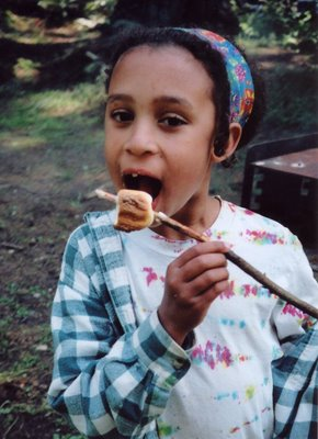 My daughter with the perfect toasted marshmallow (photo 1996)