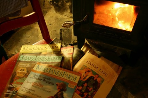 Reading magazines in front of a wood fire at the Snowshoe Country Lodge
