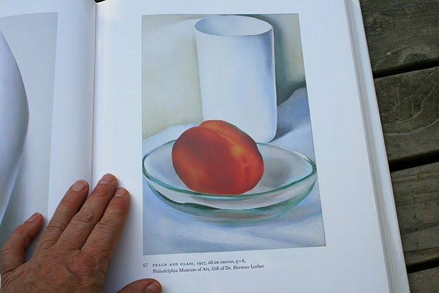 peach and glass on a still life by georgia okeeffe