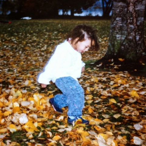 My daughter running through fall leaves, 1991