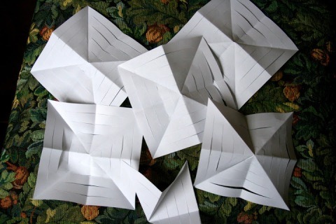Open the paper squares and press flat.
