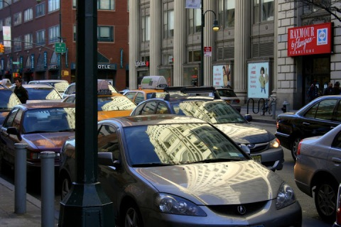 Reflections on the windows of cars and taxis