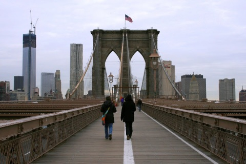 Walking across the Brooklyn Bridge toward Manhattan