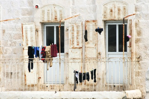 Old shutters, hanging laundry