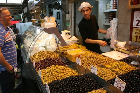 Olive vendor in the Jewish market