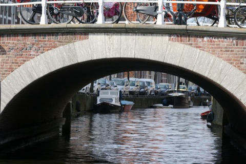 Bridges and arches over the canals; notice all the bikes on the bridge.