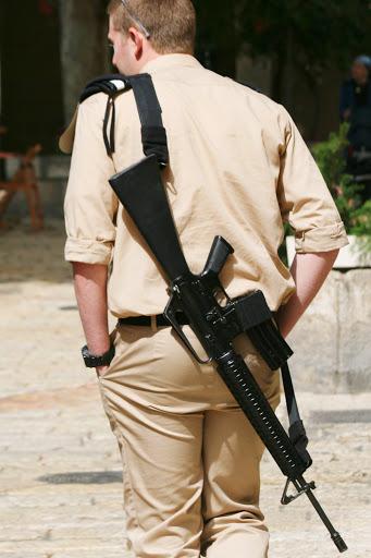 Armed Israeli soldiers patrol the streets