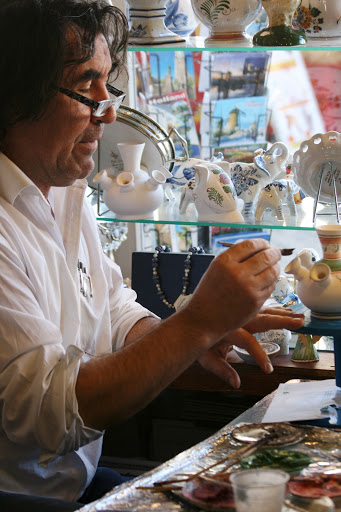 Painter at one shop demonstrating the art of Delft painting