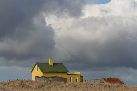 Cheerful yellow house along the Iceland coast
