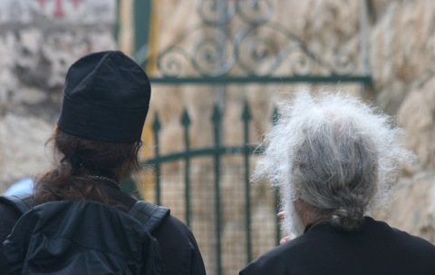 Two Orthodox priests leading a group of pilgrims to the Church of Mary Magdalene