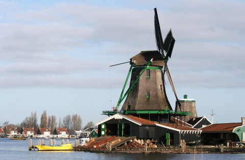 By covering the blades with canvas, the windmill catches more wind.