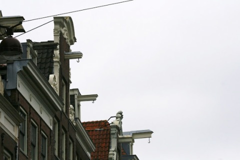 Hooks on the tops of the buildings, necessary for moving furniture into the skinny spaces