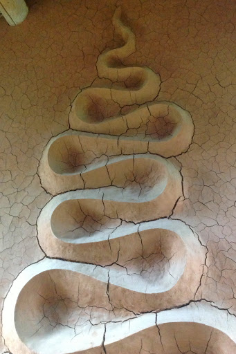 Andy Goldsworthy clay wall sculpture in the Vieil Esclangon Art Refuge