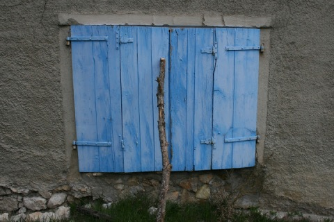 Blue doors on ruin, the village of Faissal