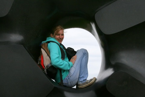 "My niece in the donut hole of Isamu Noguchi's sculpture, ""Black Sun,"" in Volunteer Park"
