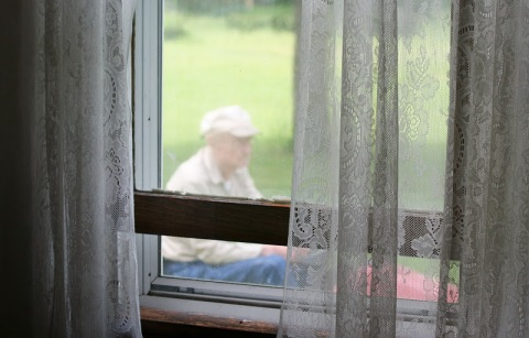 Looking through the living room window at my 94-year-old Dad mowing the lawn