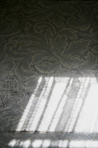 Linoleum floor with sun and shadow