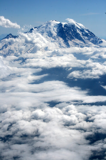 Floating in the clouds, Mount Rainier from an airplane window