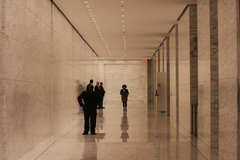 Professionals in black, taken in an office building in Midtown