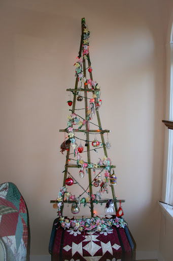 Christmas tree, a rustic wooden trellis
