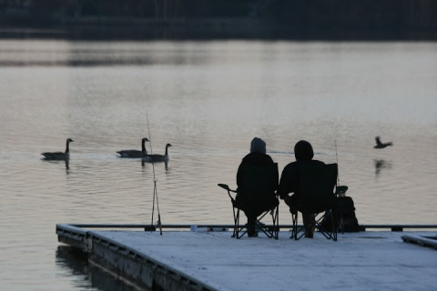 Fishing from the dock, bundled up, enjoying the natural world