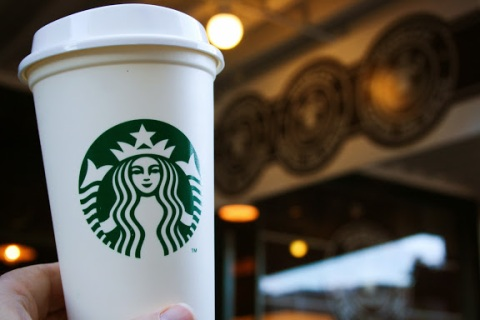 The Starbucks to-go, disposable coffee cup