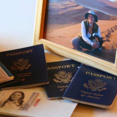 My old passports and a travel photo of me on the sand dunes of Namibia