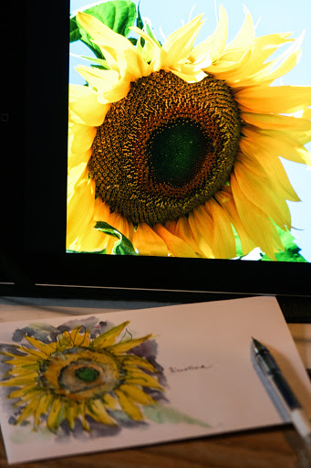 Watercolor sketch of sunflower on envelope