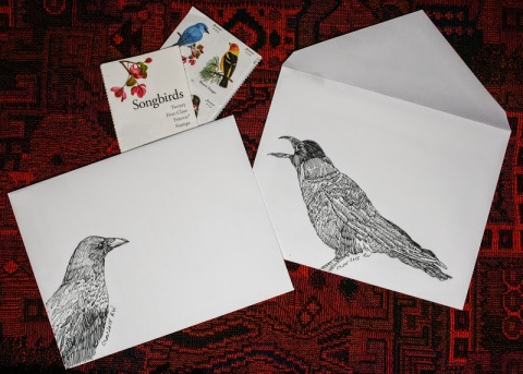 Ink sketches of crows decorate envelopes