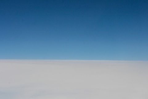 Blue sky over clouds, from my airplane window