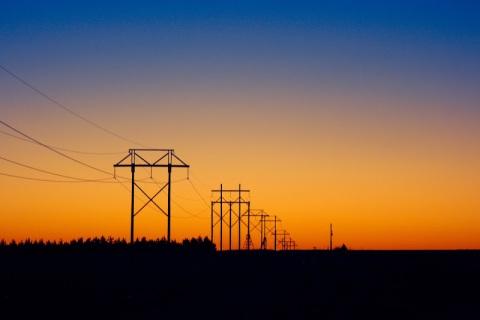 Power lines across the Nebraska landscape, near sunrise