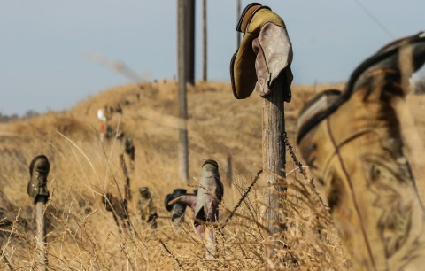 A whimsical Nebraska practice -- capping fence posts with old, discarded boots