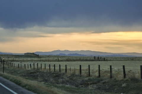 Country road with Rockies in the distance, Colorado