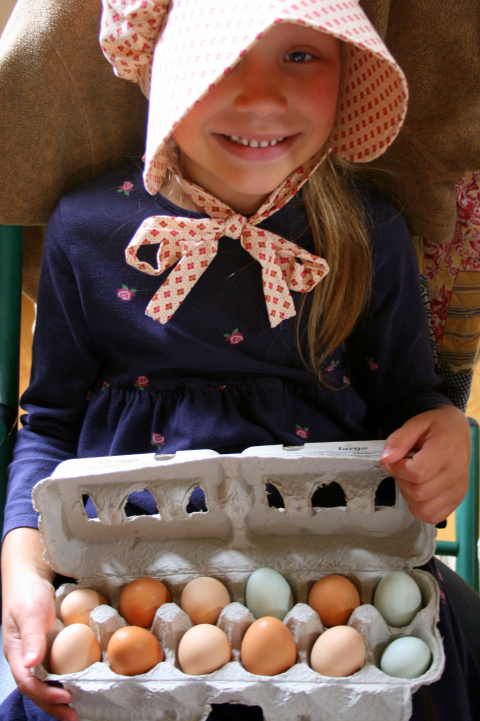 Kathryn, age 6, with home-raised eggs