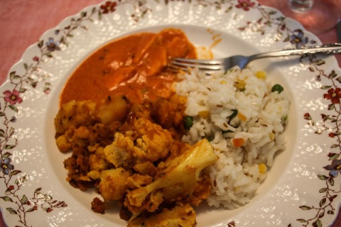 Vegetarian dinner: basmati rice with aloo gobi and paneer in sauce