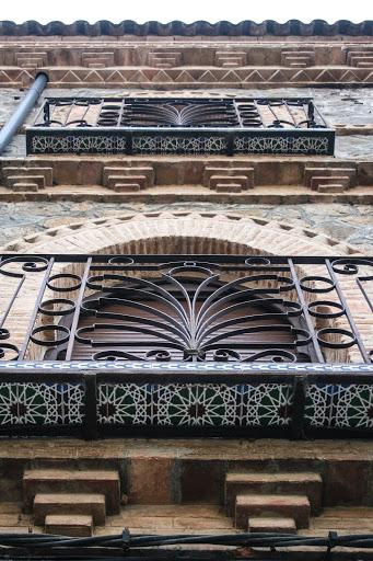 Beautiful wrought iron balconies and Moorish-influenced tiles