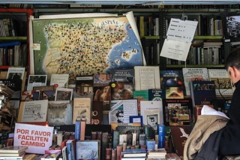 Book stalls lining a street near the Prado