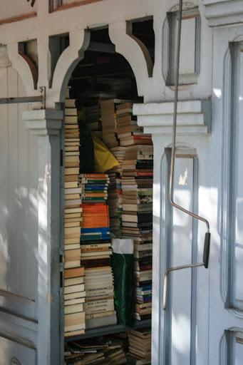 Used-book stalls lining a street near the Prado