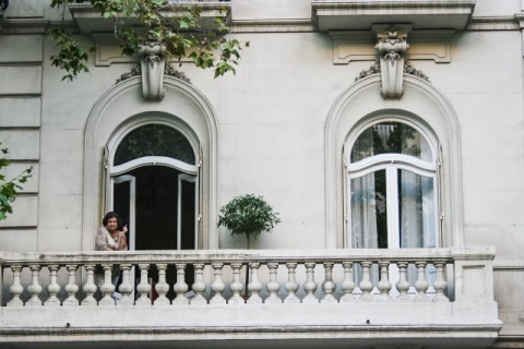 Woman smoking on balcony