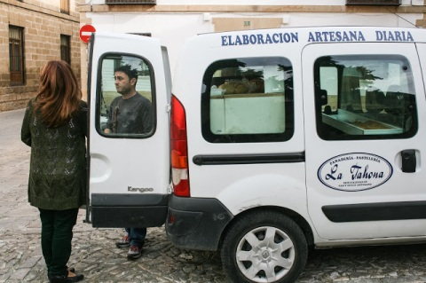 Selling bread from the back of a van in the church square, Baeza