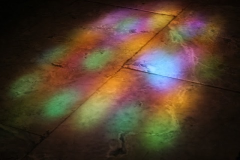 Reflections of stained glass on the floor