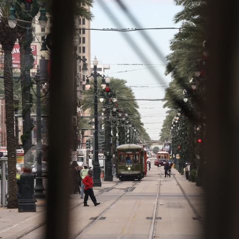 The green streetcars moved through the Garden District