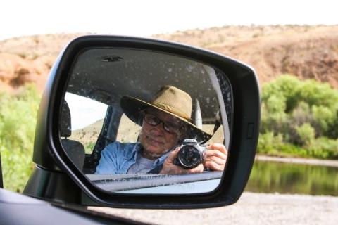 Self-portrait in side view mirror