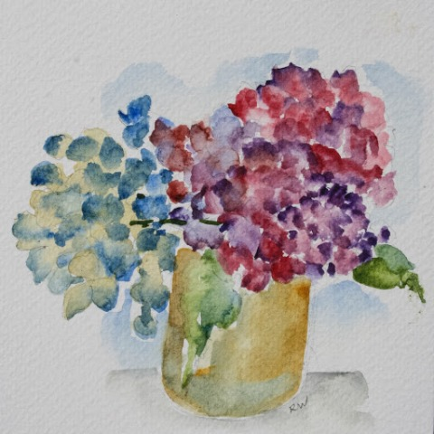 Hydrangeas in small vase