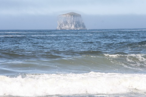 Sea stack like a ghostly phantom on the horizon