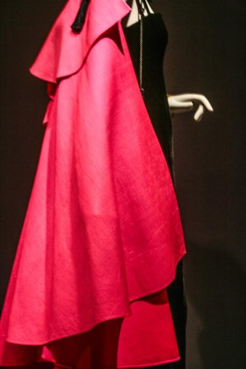 Pink ruffle cape over black sheath dress, 1977